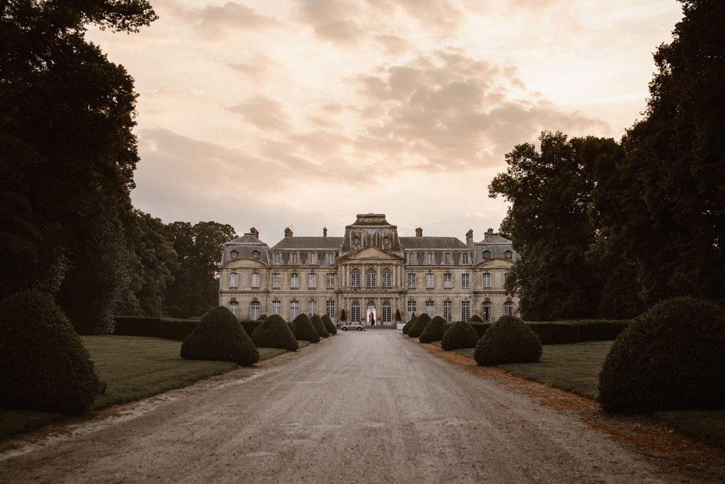 Mariage à Champlâtreux photo du chateau au coucher de soleil